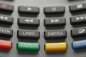 A close up of a black keyboard typing video subtitles
