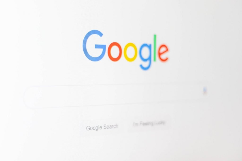 A close up of Google text on a white background