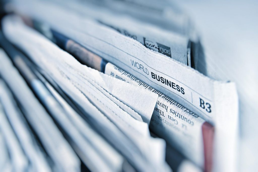 A close up of business section of newspaper